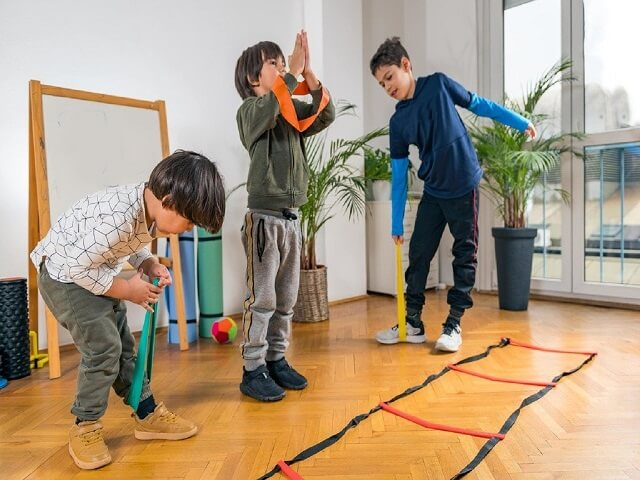 Three boys exercising at home