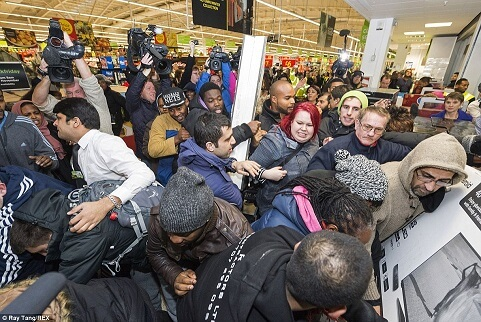 Sales chaos with crowds fighting over reduced items